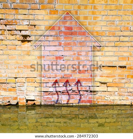 Brick wall damaged by rising damp with copy space - stock photo
