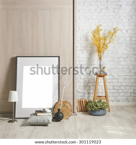 brick wall interior with frame and yellow flower  - stock photo