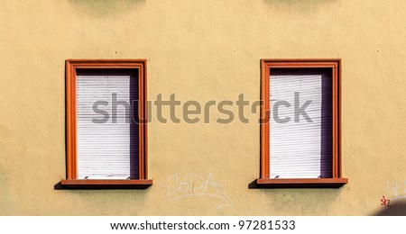 brick wall of an old house with window - stock photo