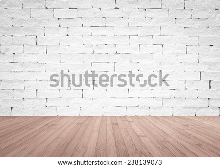 Brick wall painted in white color tone with wooden floor textured background in red brown color tone  - stock photo
