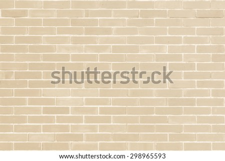 Brick wall texture pattern background in natural light ancient cream beige yellow brown color tone: Masonry brick work wall detail textured backdrop   - stock photo
