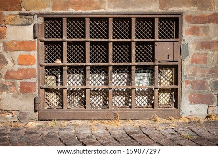 brick wall with a window background texture - stock photo