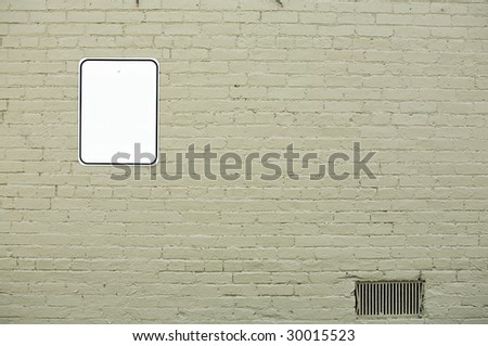 brick wall with blank sign - stock photo