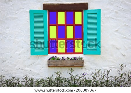 Brick Wall with Coloured Glass Window - stock photo