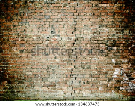 Brick wall with crack - stock photo