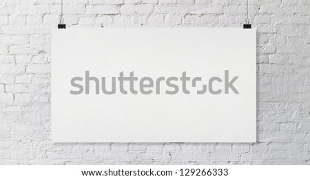 brick wall with crafted poster - stock photo