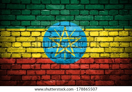 Brick wall with painted flag of Ethiopia - stock photo