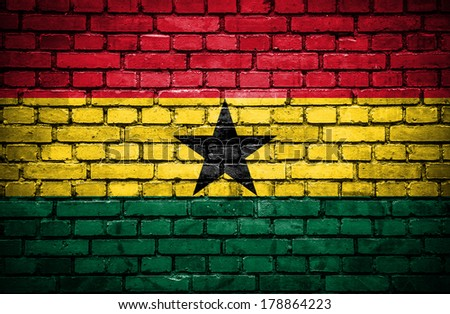 Brick wall with painted flag of Ghana - stock photo