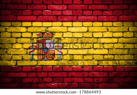 Brick wall with painted flag of Spain - stock photo