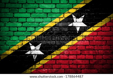 Brick wall with painted flag of St Kitts and Nevis - stock photo