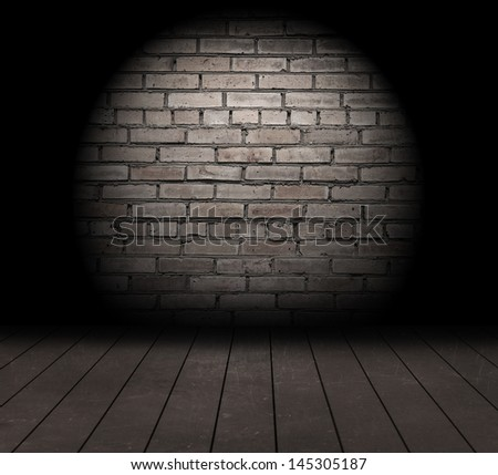 Brick wall with spot light and wood floor texture. - stock photo