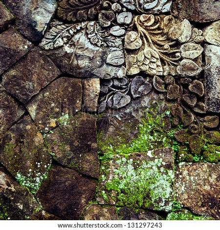 brick wall with stone carving - stock photo