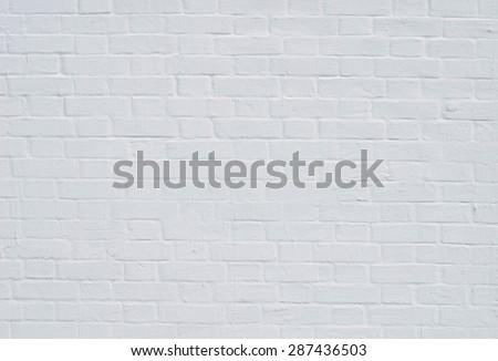 Brick wall with whitewashing by close up - stock photo