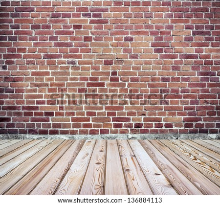 Brick wall with wooden floor - stock photo