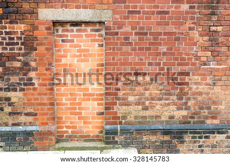 Bricked up doorway on a brick wall background available for copy space. - stock photo & Stock Images similar to ID 469062974 - brick wall Pezcame.Com