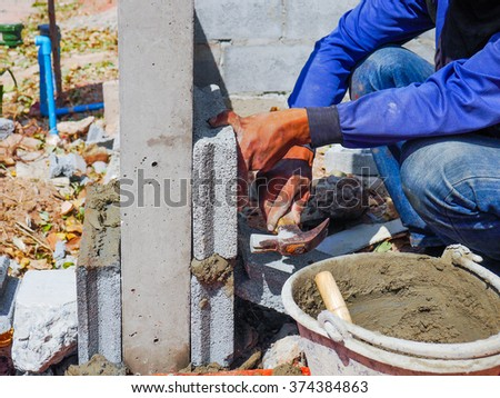 bricklayer during his work - stock photo