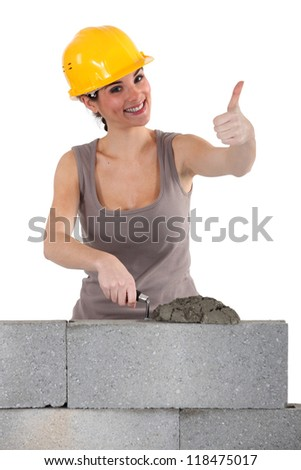 Bricklayer giving the thumb's up - stock photo