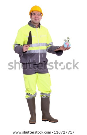 Bricklayer with a globe - stock photo