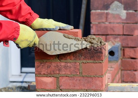 Bricklaying - making gate post - stock photo