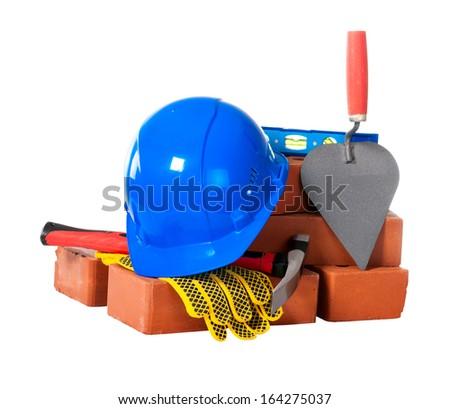 Bricks and masonry tools. Isolation. - stock photo