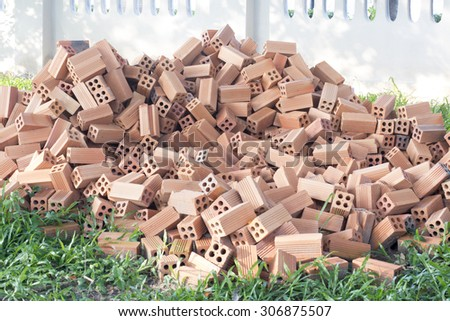 Bricks prepare for construction placed on the lawn - stock photo