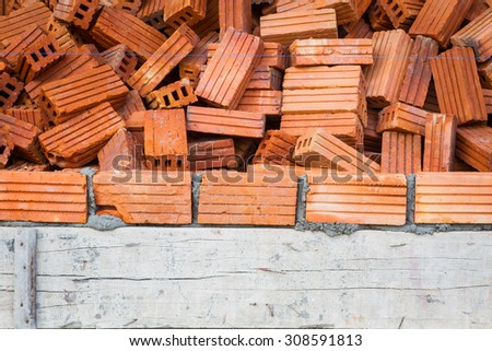bricks with wet layer concrete in construction site, vignette. - stock photo