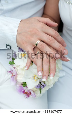 bridal bouquet and hands - stock photo