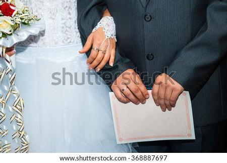 bridal bouquet bride and groom on the Ukrainian wedding - stock photo