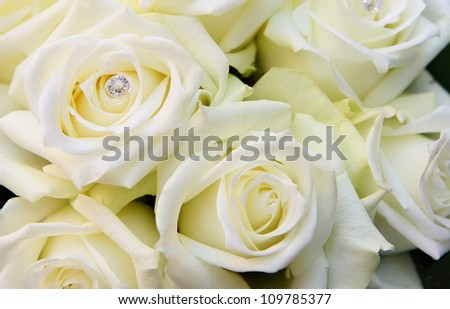 Bridal bouquet made of beautiful white roses with diamonds. - stock photo