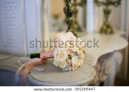 Bridal bouquet of light pink roses lying on a marble table - stock photo