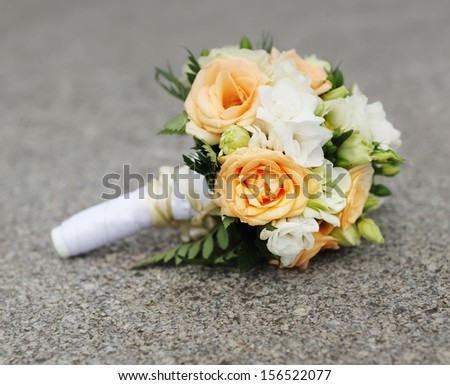 Bridal bouquet of various flowers on ground - stock photo