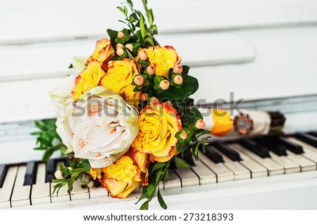 Bridal Bouquet on the piano - stock photo