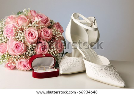 bridal bouquet posy with wedding shoes and rings - stock photo