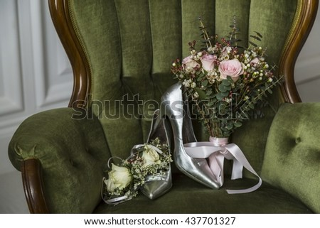 Bridal bouquet, wedding flowers for the ceremony on the chair with shoes - stock photo