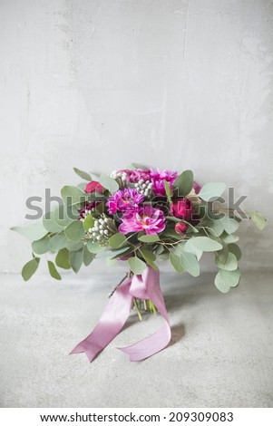 Bridal bouquet with red and burgundy colors - stock photo