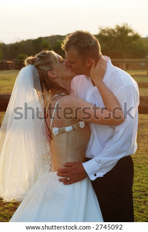 Bridal couple holding each other just after the wedding ceremony. - stock photo