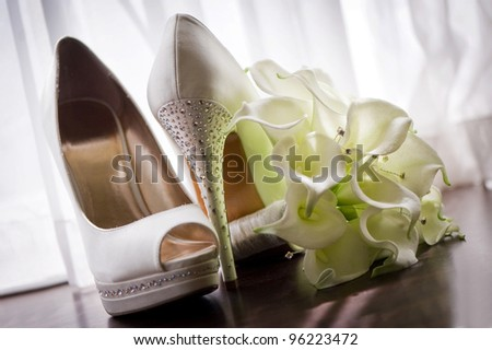 Bridal shoes and bouquet - stock photo