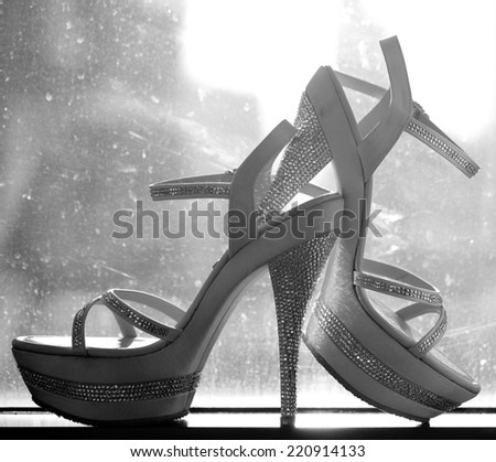 Bridal shoes at the window  - stock photo