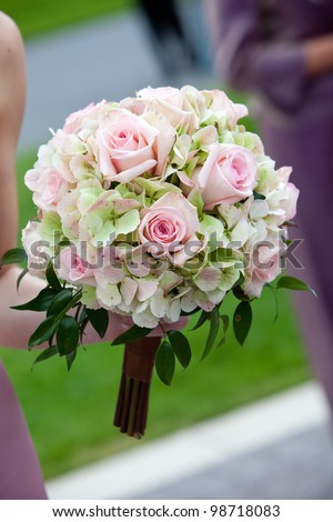 bridal wedding bouquet of flowers in white, pink, and green - stock photo