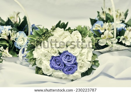 Bride and bridesmaids vintage-colored wedding bouquets - stock photo