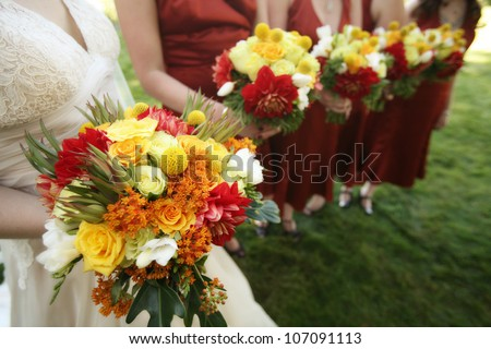 Bride and Bridesmaids with Bouquets at a Wedding - stock photo
