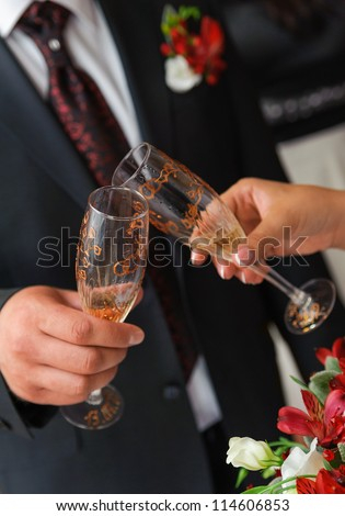 bride and groom a clink glasses. Wedding couple - stock photo