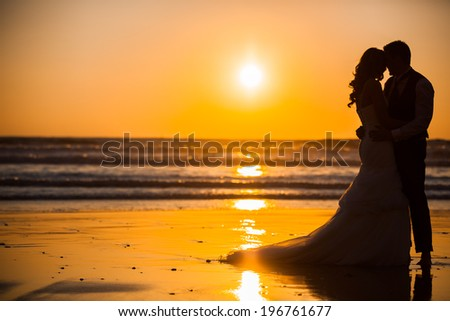 Bride and Groom at Sunset  Romantic Married Couple - stock photo
