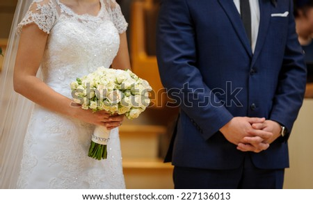 Bride and groom at the church ceremony - stock photo