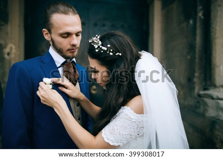Bride and groom at wedding Day embracing with love. Happy romantic young couple celebrating their marriage - stock photo