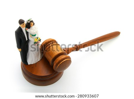 Bride and groom cake topper couple with legal gavel  - stock photo