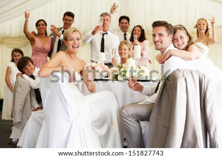 Bride And Groom Celebrating With Guests At Reception - stock photo