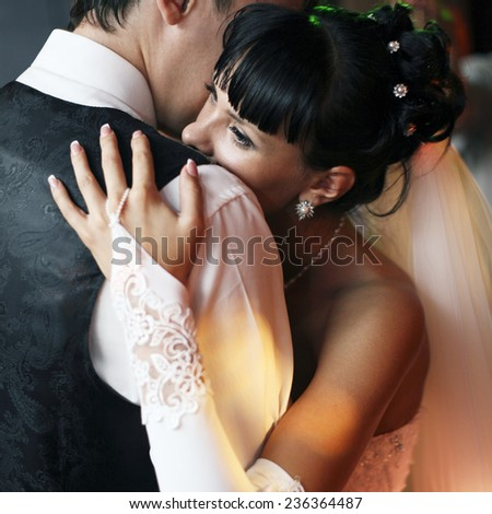 bride and groom dancing in the restaurant - stock photo