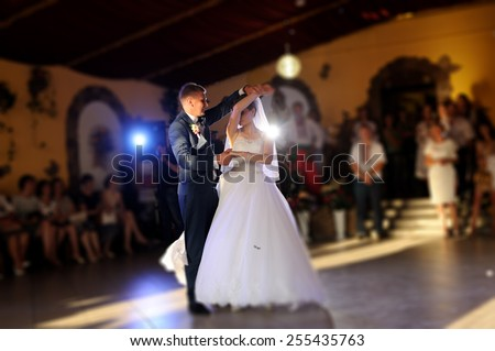 bride and groom dancing on the own wedding - stock photo