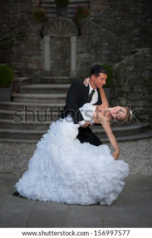 Bride and groom dancing their first dance - wedding photography - stock photo